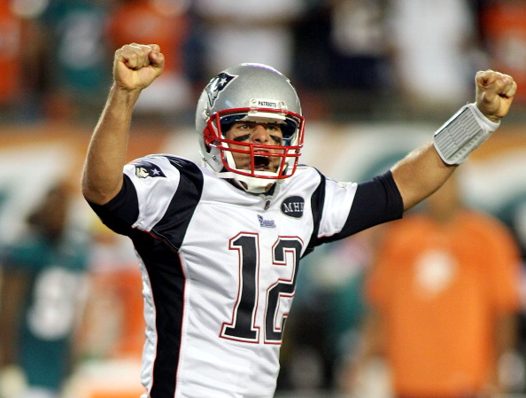 MIAMI GARDENS, FL - SEPTEMBER 12:  Quarterback Tom Brady #12 of the New England Patriots celebrates a touchdown against the Miami Dolphins at Sun Life Stadium on September 12, 2011 in Miami Gardens, Florida.  (Photo by Marc Serota/Getty Images)