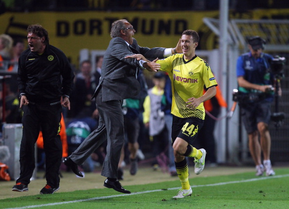 DORTMUND, GERMANY - SEPTEMBER 13:  Ivan Perisic of Borussia Dortmund celebrates scoring a goal during the UEFA Champions League Group F first leg match between Borussia Dortmund and Arsenal FC at Signal Iduna Park on September 13, 2011 in Dortmund, Germany.  (Photo by Ian Walton/Getty Images)