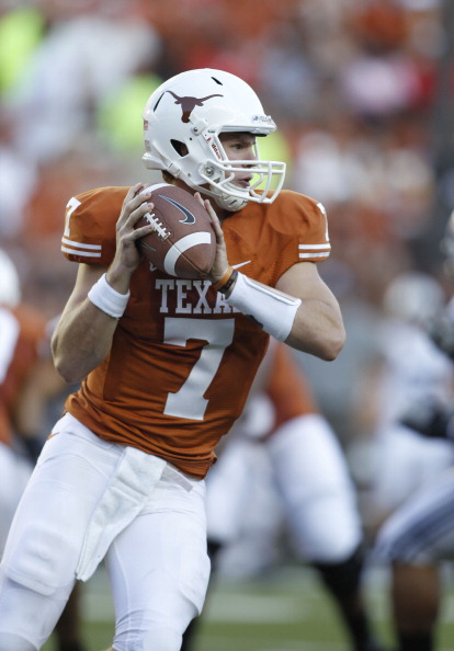 AUSTIN, TX - SEPTEMBER 10:  Quarterback Garrett Gilbert #7 of the Texas Longhorns rolls out for a first quarter pass against the BYU Cougars on September 10, 2011 at Darrell K. Royal-Texas Memorial Stadium in Austin, Texas. Gilbert was replaced in the second half by two backup quarterbacks.  Texas defeated BYU 17-16. (Photo by Erich Schlegel/Getty Images