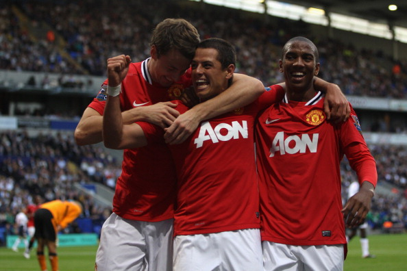 BOLTON, ENGLAND - SEPTEMBER 10:  Javier Hernandez (C) of Manchester United celebrates scoring the fourth goal with Ashley Young (R) and Johnny Evans (L)  during the Barclays Premier League at the Reebok Stadium on September 10, 2011 in Bolton, England.  (Photo by Michael Steele/Getty Images)