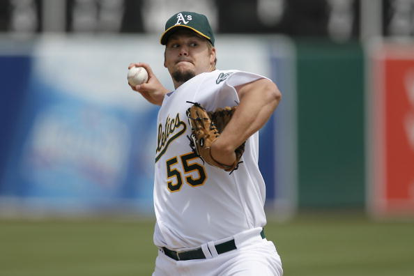 OAKLAND, CA - MAY 25:  Pitcher Joe Blanton #55 of the Oakland Athletics delivers a pitch against the Boston Red Sox on May 25, 2008 at McAfee Coliseum in Oakland, California. Oakland won 6 to 3.  (Photo by Greg Trott/Getty Images)
