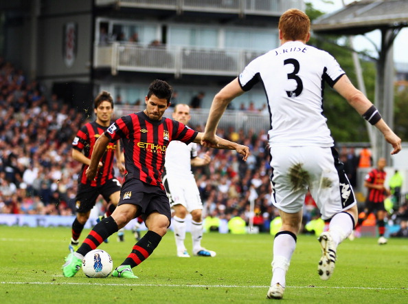LONDON, ENGLAND - SEPTEMBER 18:  Sergio Aguero of Manchester City shoots and scores his sides second goal during the Barclays Premier League match between Fulham and Manchester City at Craven Cottage on September 18, 2011 in London, England.  (Photo by Julian Finney/Getty Images)