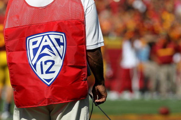 LOS ANGELES - SEPTEMBER 3:   A sideline official wears a vest with the logo for the Pac 12 conference during the game between the Minnesota Golden Gophers and the USC Trojans at the Los Angeles Memorial Coliseum on September 3, 2011 in Los Angeles, California.  USC won 19-17. (Photo by Stephen Dunn/Getty Images)