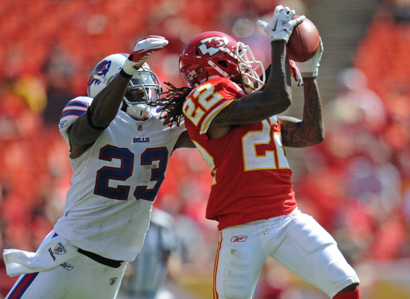 KANSAS CITY, MO - SETEMBER 11:  Wide receiver Dexter McCluster #22 of the Kansas City Chiefs catches a pass against pressure from defensive back Aaron Williams #23 of the Buffalo Bills during the fourth quarter on September 11, 2011 at Arrowhead Stadium in Kansas City, Missouri.  The Bills beat the Chiefs 41-7.(Photo by Peter Aiken/Getty Images)