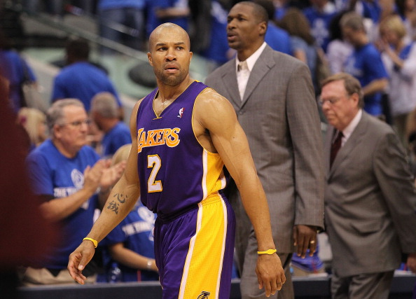 DALLAS, TX - MAY 06:  Guard Derek Fisher #2 of the Los Angeles Lakers leaves the court after a 98-92 loss against the Dallas Mavericks in Game Three of the Western Conference Semifinals during the 2011 NBA Playoffs on May 6, 2011 at American Airlines Center in Dallas, Texas.  NOTE TO USER: User expressly acknowledges and agrees that, by downloading and or using this photograph, User is consenting to the terms and conditions of the Getty Images License Agreement.  (Photo by Ronald Martinez/Getty Images)