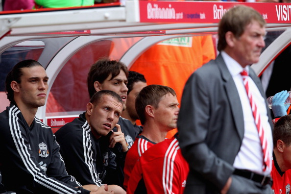 STOKE ON TRENT, ENGLAND - SEPTEMBER 10:  Andy Crroll (L) and Craig Bellamy sit on the Liverpool  bench behind their manager Kenny Dalglish prior to the Barclays Premier League match between Stoke City and Liverpool at Britannia Stadium on September 10, 2011 in Stoke on Trent, England.  (Photo by Scott Heavey/Getty Images)