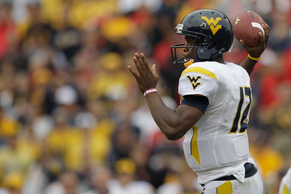 COLLEGE PARK, MD - SEPTEMBER 17: Quarterback Geno Smith #12 of the West Virginia Mountaineers drops back to pass against the Maryland Terrapins during the second half at Byrd Stadium on September 17, 2011 in College Park, Maryland. West Virginia defeated Maryland 37-31.  (Photo by Rob Carr/Getty Images)