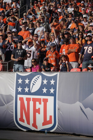 DENVER, CO - SEPTEMBER 18:  Fans cheer from the stands as the Cincinnati Bengals face the Denver Broncos at Sports Authority Field at Mile High on September 18, 2011 in Denver, Colorado. The Broncos defeated the Bengals 24-22.  (Photo by Doug Pensinger/Getty Images)