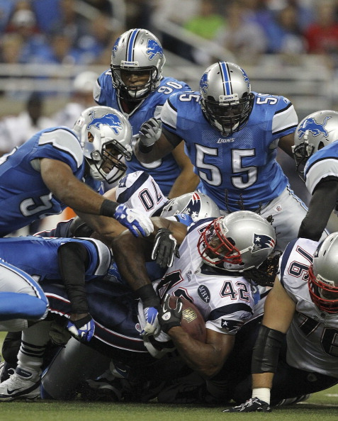 DETROIT - AUGUST 27:  Justin Durant #57 and Ndamukong Suh #90 of the Detroit Lions makes the stop on BenJavus Green-Ellis #42 of the New England Patriots during the first quarter of the game at Ford Field on August 27, 2011 in Detroit, Michigan.  (Photo by Leon Halip/Getty Images)