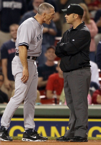 BOSTON, MA - AUGUST 30:  Manager Joe Girardi #28 of the New York Yankees argues in the ninth inning with Mark Wegner after Jarrod Saltalamacchia of the Boston Red Sox was hit by a pitch in the ninth inning on August 30, 2011 at Fenway Park in Boston, Massachusetts.  (Photo by Elsa/Getty Images)