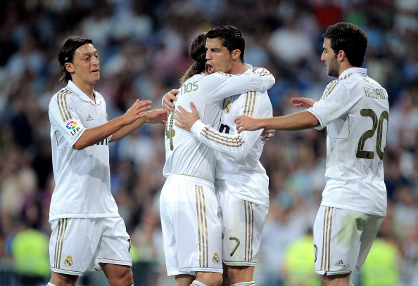 MADRID, SPAIN - SEPTEMBER 24:  Cristiano Ronaldo (C) of Real Madrid celebrates with Mesut Ozil (L) and Gonzalo Higuain (R) after scoring Real's 4th goal during the La Liga match between Real Madrid and Rayo Vallecano at Estadio Santiago Bernabeu on September 24, 2011 in Madrid, Spain.  (Photo by Denis Doyle/Getty Images)