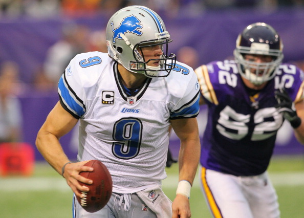 MINNEAPOLIS, MN - SEPTEMBER 25:  Matthew Stafford #9 of the Detroit Lions is chased by Chad Greenway #52 of the Minnesota Vikings in the third quarter at the Hubert H. Humphrey Metrodome on September 25, 2011 in Minneapolis, Minnesota.  (Photo by Adam Bettcher /Getty Images)