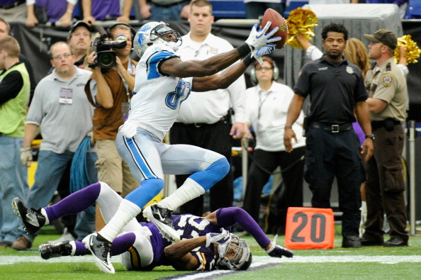 MINNEAPOLIS, MN - SEPTEMBER 25: Calvin Johnson #81 of the Detroit Lions makes a catch over Cedric Griffin #23 of the Minnesota Vikings in overtime on September 25, 2011 at Hubert H. Humphrey Metrodome in Minneapolis, Minnesota. The Lions defeated the Vikings 26-23. (Photo by Hannah Foslien/Getty Images)