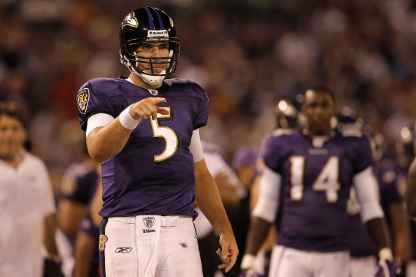 BALTIMORE, MD - AUGUST 25:  Quarterback Joe Flacco #5 of the Baltimore Ravens celebrates a touchdown against the Washington Redskins during the second half of a preseason game at M&T Bank Stadium on August 25, 2011 in Baltimore, Maryland. The Ravens defeated the Redskins 34-31.  (Photo by Rob Carr/Getty Images)