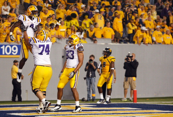 MORGANTOWN, WV - SEPTEMBER 24:  Alfred Blue #4 of the Louisiana State University Tigers celebrates with teammate Josh Williford #74 after scoring against the West Virginia Mountaineers during the game on September 24, 2011 at Mountaineer Field in Morgantown, West Virginia.  (Photo by Jared Wickerham/Getty Images)