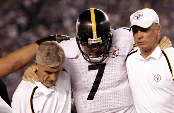 SAN DIEGO -  OCTOBER 10:  Quarterback Ben Roethlisberger #7 of the Pittsburgh Steelers is helped off the field by team physicians with an injured left knee during the Steelers' game-winning drive in NFL action against the San Diego Chargers October 10, 2005 at Qualcomm Stadium in San Diego, California. (Photo by Donald Miralle/Getty Images)