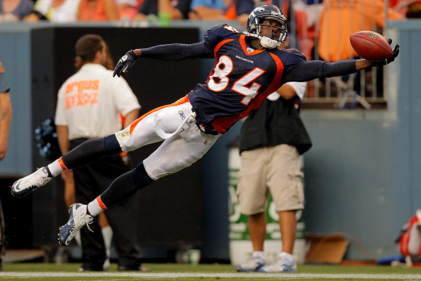 DENVER, CO - AUGUST 20:  Wide receiver Brandon Lloyd #84 of the Denver Broncos lays out but is unable to haul in a pass during the first half against the Buffalo Bills at Sports Authority Field at Mile High on August 20, 2011 in Denver, Colorado. (Photo by Justin Edmonds/Getty Images)