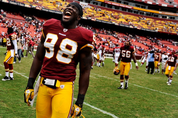 LANDOVER, MD - SEPTEMBER 18: Linebacker Brian Orakpo #98 of the Washington Redskins celebrates after defeating the Arizona Cardinals at FedExField on September 18, 2011 in Landover, Maryland. The Washington Redskins won, 22-21. (Photo by Patrick Smith/Getty Images)