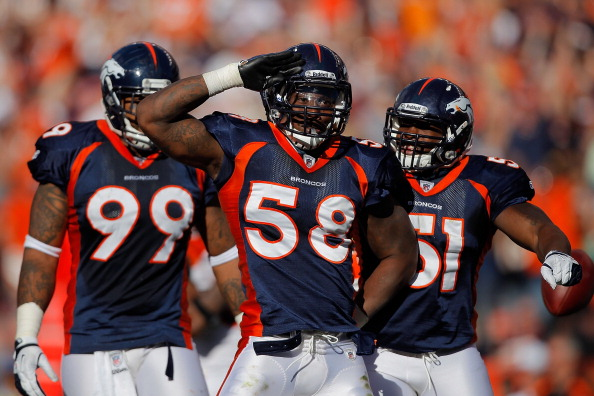 DENVER, CO - SEPTEMBER 18:  Linebacker Von Miller #58 of the Denver Broncos salutes to the fans and celebrates with teammates defensive tackle Kevin Vickerson #99 and linebacker Joe Mays #51 after making a sack on Cincinnati Bengals quarterback Andy Dalton during the fourth quarter at Sports Authority Field at Mile High on September 18, 2011 in Denver, Colorado. (Photo by Justin Edmonds/Getty Images)
