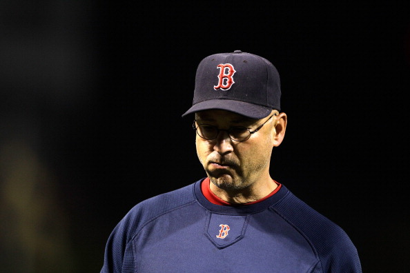 BALTIMORE, MD - SEPTEMBER 27:  Manager Terry Francona #47 of the Boston Red Sox walks back to the dugout during the eighth inning against the Baltimore Orioles at Oriole Park at Camden Yards on September 27, 2011 in Baltimore, Maryland. The Red Sox defeated the Orioles 8-7.  (Photo by Rob Carr/Getty Images)