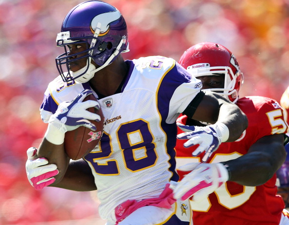 KANSAS CITY, MO - OCTOBER 02:  Adrian Peterson #28 of the Minnesota Vikings carries the ball as linebacer Justin Houston #50 of the Kansas City Chiefs defends during the game on October 2, 2011 at Arrowhead Stadium in Kansas City, Missouri.  (Photo by Jamie Squire/Getty Images)