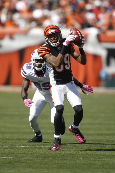CINCINNATI, OH - OCTOBER 2:   Jerome Simpson #89 of the Cincinnati Bengals makes the catch against Drayton Florence #29 of the Buffalo Bills during their game on October 2, 2011 at Paul Brown Stadium in Cincinnati, Ohio.  The Bengals defeated the Bills 23-20.  (Photo by John Grieshop/Getty Images)