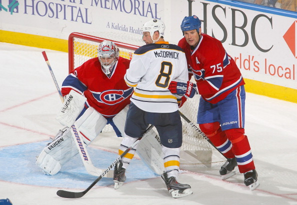 BUFFALO, NY - OCTOBER 15: Carey Price #31 and Hal Gill #75 of the Montreal Canadiens defend against Cody McCormick # 8 of the Buffalo Sabres  at HSBC Arena on October 15, 2010 in Buffalo, New York.  Montral won 2-1.(Photo by Rick Stewart/Getty Images)