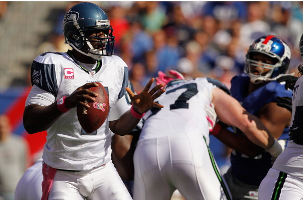 EAST RUTHERFORD, NJ - OCTOBER 09:  Tarvaris Jackson #7 of the Seattle Seahawks looks turnover pass against the New York Giants at MetLife Stadium on October 9, 2011 in East Rutherford, New Jersey.Seahawks defeated the Giants 36-25.  (Photo by Mike Stobe/Getty Images)