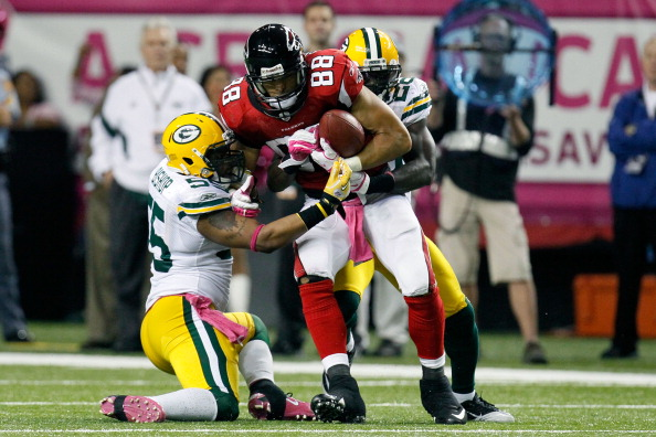 ATLANTA, GA - OCTOBER 09:  Tony Gonzalez #88 of the Atlanta Falcons is tackled by Desmond Bishop #55 of the Green Bay Packers at Georgia Dome on October 9, 2011 in Atlanta, Georgia.  (Photo by Kevin C. Cox/Getty Images)