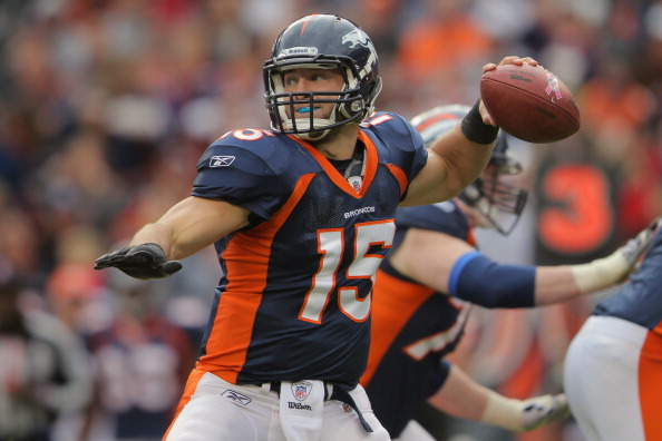 DENVER, CO - OCTOBER 09:  Quarterback Tim Tebow #15 of the Denver Broncos delivers a pass against the San Diego Chargers at Sports Authority Field at Mile High on October 9, 2011 in Denver, Colorado. The Chargers defeated the Broncos 29-24.  (Photo by Doug Pensinger/Getty Images)