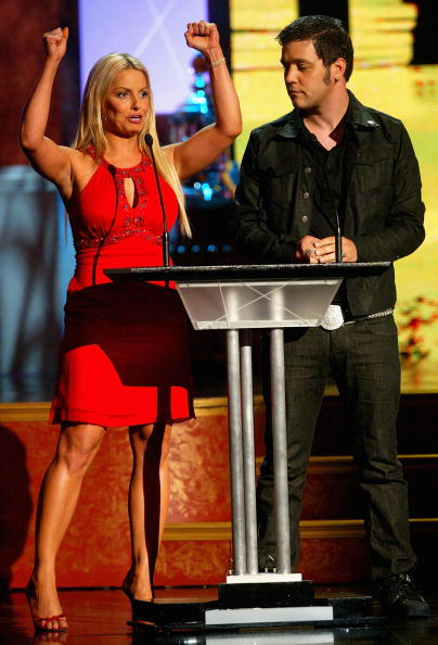 TORONTO, ON - JUNE 14:  WWF wrestler Trish Stratus and George Stroumboulopoulos present the Vezina Trophy for Top Goalie in the NHL onstage during the 2007 NHL Awards Show at the Elgin Theatre on June 14, 2007 in Toronto, Ontario.  (Photo by Dave Sandford/Getty Images)