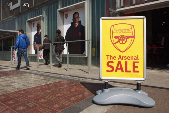 LONDON, ENGLAND - APRIL 11:  A sale sign is displayed outside the fan shop of Arsenal Football Club's Emirates Stadium on April 11, 2011 in London, England. American businessman Stan Kroenke's company 'Kroenke Sports Enterprises' has increased its shareholding in Arsenal to 62.89% and will make an offer for a full takeover of the club. Kronke first purchased 9.9% of Arsenal shares in 2007. Today's deal values the Premier League club at 731m GBP.  (Photo by Oli Scarff/Getty Images)