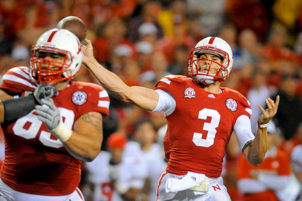 LINCOLN, NE - OCTOBER 8: Quarterback Taylor Martinez #3 of the Nebraska Cornhuskers throws downfield against the Ohio State defense during their game at Memorial Stadium October 8, 2011 in Lincoln, Nebraska. Nebraska Defeated Ohio State 34-27. (Photo by Eric Francis/Getty Images)