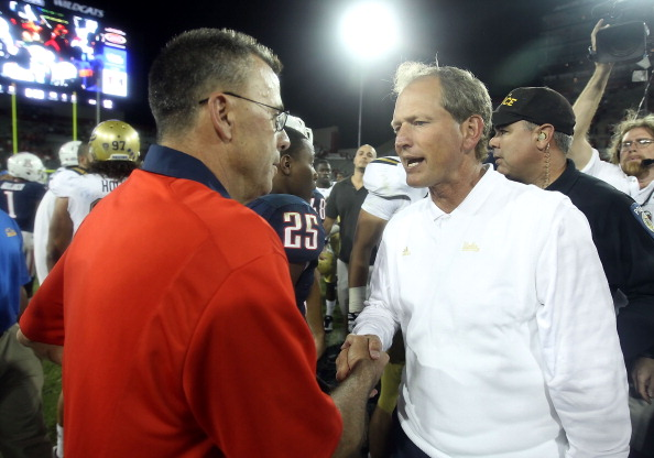 TUCSON, AZ - OCTOBER 20:  Head coach Rick Neuheisel of the UCLA Bruins greets interim head coach Tim Kish of the Arizona Wildcats following the college football game at Arizona Stadium on October 20, 2011 in Tucson, Arizona. The Wildcats defeated the Bruins 48-12. (Photo by Christian Petersen/Getty Images)
