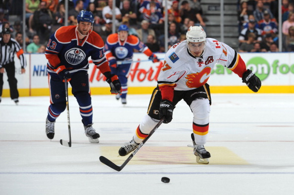 EDMONTON, CANADA - SEPTEMBER 23: Rene Bourque #17 of the Calgary Flames skates against the Edmonton Oilers on September 23, 2011 at Rexall Place in Edmonton, Alberta, Canada. (Photo by Dale MacMillan/Getty Images)
