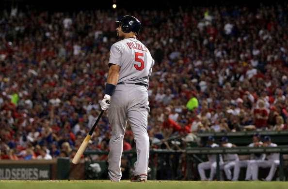 ARLINGTON, TX - OCTOBER 22:  Albert Pujols #5 of the St. Louis Cardinals watches the ball after hitting a solo home run in the ninth inning for his third home run of the night during Game Three of the MLB World Series against the Texas Rangers at Rangers Ballpark in Arlington on October 22, 2011 in Arlington, Texas. The Cardinals won 16-7.  (Photo by Doug Pensinger/Getty Images)