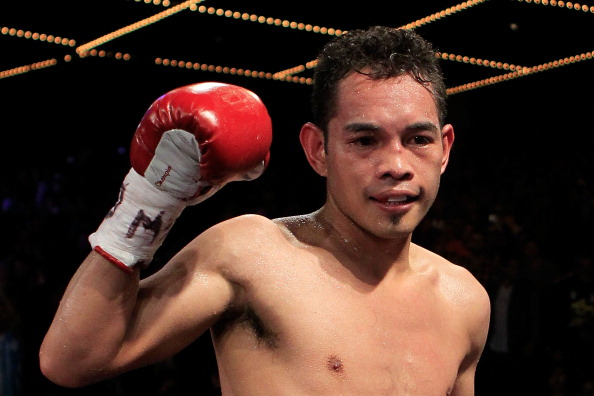 NEW YORK - OCTOBER 22:  Nonito Donaire of the Philippines celebrates defeating Omar Narvaez of Argentina and defending his WBC, WBO World Bantamweight Titles at Madison Square Garden on October 22, 2011 in New York City.  (Photo by Chris Trotman/Getty Images)