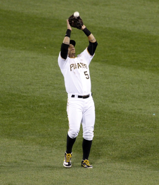 PITTSBURGH, PA - SEPTEMBER 24:  Ronny Cedeno #5 of the Pittsburgh Pirates plays the field against the Cincinnati Reds during the game on September 24, 2011 at PNC Park in Pittsburgh, Pennsylvania.  (Photo by Justin K. Aller/Getty Images)