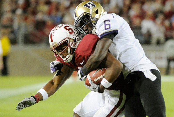 Stanford Cardinal, CA - OCTOBER 22:  Desmond Trufant #6 of Washington Huskies tackles Chris Owusu #81 of the Stanford Cardinal at Stanford Stadium on October 22, 2011 in Stanford, California. Stanford won the game 65-21. (Photo by Thearon W. Henderson/Getty Images)