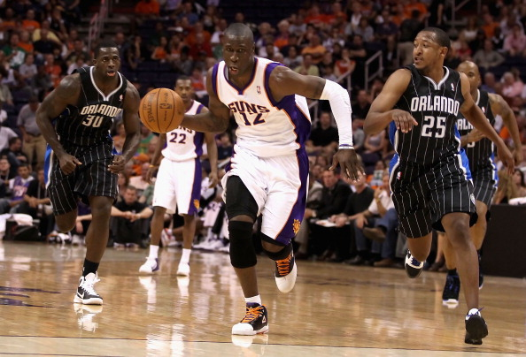 PHOENIX, AZ - MARCH 13:  Mickael Pietrus #12 of the Phoenix Suns handles the ball during the NBA game against the Orlando Magic at US Airways Center on March 13, 2011 in Phoenix, Arizona.  NOTE TO USER: User expressly acknowledges and agrees that, by downloading and or using this photograph, User is consenting to the terms and conditions of the Getty Images License Agreement.  (Photo by Christian Petersen/Getty Images)