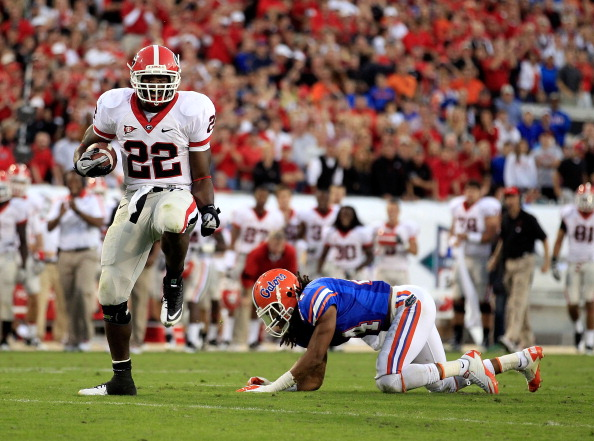 JACKSONVILLE, FL - OCTOBER 29:  Richard Samuel #22 of the Georgia Bulldogs runs for yardage past Josh Evans #24 of the Florida Gators during the game at EverBank Field on October 29, 2011 in Jacksonville, Florida.  (Photo by Sam Greenwood/Getty Images)
