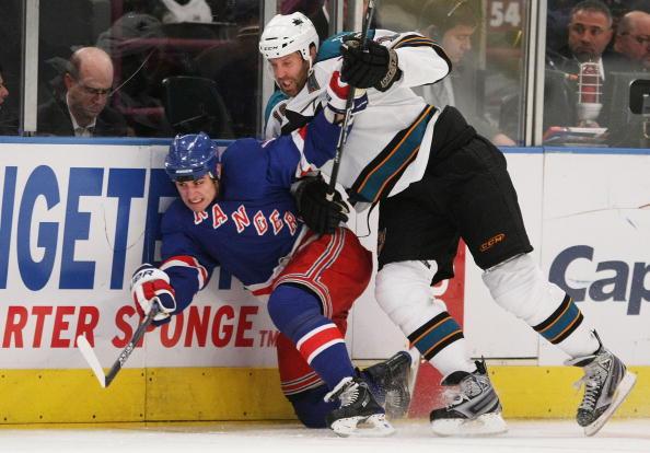 NEW YORK - OCTOBER 19:  Joe Thornton #19 of the San Jose Sharks hits Brandon Dubinsky #17 of the New York Rangers at Madison Square Garden on October 19, 2009 in New York, New York. The Sharks defeated the Rangers 7-3.  (Photo by Bruce Bennett/Getty Images)