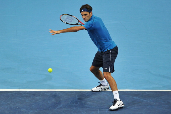 BASEL, SWITZERLAND - NOVEMBER 02:  Roger Federer of Switzerland in action in his match against Jarkko Nieminen of Finland during day three of the Swiss Indoors at St Jakobshalle on November 2, 2011 in Basel, Switzerland.  (Photo by Harold Cunningham/Getty Images)