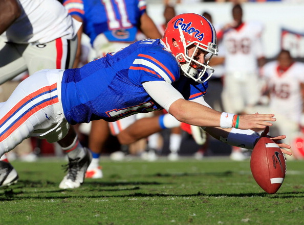JACKSONVILLE, FL - OCTOBER 29:  John Brantley #12 of the Florida Gators dives for a loose ball during the game against the Georgia Bulldogs at EverBank Field on October 29, 2011 in Jacksonville, Florida.  (Photo by Sam Greenwood/Getty Images)