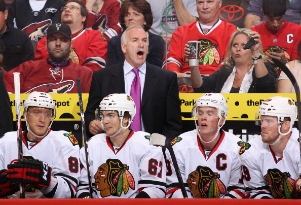 GLENDALE, AZ - OCTOBER 18:  Head coach Joel Quenneville of the Chicago Blackhawks reacts on the bench during the NHL game against the Phoenix Coyotes at Jobing.com Arena on October 18, 2011 in Glendale, Arizona. The Blackhawks defeated the Coyotes 5-2.  (Photo by Christian Petersen/Getty Images)