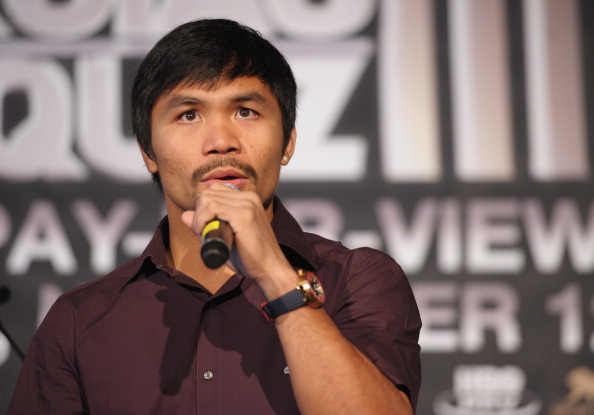 NEW YORK, NY - SEPTEMBER 06:  Professional Boxer Manny Pacquiao (pictured) sings during the press conference for his World Welterweight Championship Fight with Juan Manuel Marquez at The Lighthouse at Chelsea Piers on September 6, 2011 in New York City.  (Photo by Michael Loccisano/Getty Images)