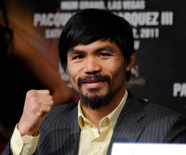 LAS VEGAS, NV - NOVEMBER 09:  Boxer Manny Pacquiao poses during the final news conference for his bout with Juan Manuel Marquez at the MGM Grand Hotel/Casino November 9, 2011 in Las Vegas, Nevada. Pacquiao will defend his WBO welterweight title against Marquez when the two meet in the ring for the third time on November 12 in Las Vegas.  (Photo by Ethan Miller/Getty Images)