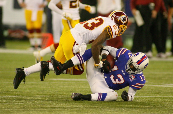 TORONTO, ON - OCTOBER 30: Steve Johnson #13 of the Buffalo Bills is tackled by DeAngelo Hall #23 of the Washington Redskins  at Rogers Centre on October 30, 2011 in Toronto, Ontario, Canada. Buffalo won 23-0.  (Photo by Rick Stewart/Getty Images)