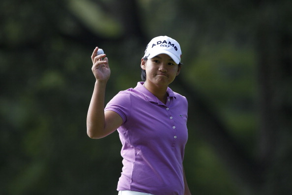 GUADALAJARA, MEXICO - NOVEMBER 11:  Yani Tseng of Taiwan acknowledges the gallery during the second round of the Lorena Ochoa Invitational Presented by Banamex and Jalisco It Happens Within You held at Guadalajara Country Club on November 11, 2011 in Guadalajara, Mexico.  (Photo by Michael Cohen/Getty Images)