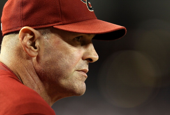 PHOENIX, AZ - SEPTEMBER 28:  Manager Kirk Gibson of the Arizona Diamondbacks watches from the dugout during the Major League Baseball game against the Los Angeles Dodgers at Chase Field on September 28, 2011 in Phoenix, Arizona.  The Dodgers defeated the Diamondbacks 7-5. (Photo by Christian Petersen/Getty Images)